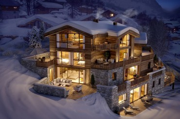 Illuminated chalet apartments in Val d'Isère at night